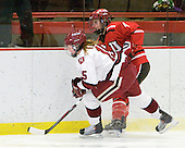 Katharine Chute (Harvard - 15), Josee Belanger (St. Lawrence - 4) - The Harvard University Crimson defeated the St. Lawrence University Saints 8-3 (EN) to win their ECAC Quarterfinals on Saturday, February 26, 2011, at Bright Hockey Center in Cambridge, Massachusetts.