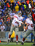 23 December 2007: New York Giants quarterback Eli Manning makes a forward pass against the Buffalo Bills at Ralph Wilson Stadium in Orchard Park, NY. The Giants defeated the Bills 38-21. ..Mandatory Photo Credit: Ed Wolfstein Photo