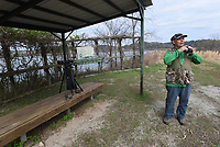 NWA Democrat-Gazette/FLIP PUTTHOFF <br />A wildlife viewing blind is available to visitors. Joe Neal looks at birds March 23 2017 near the blind.