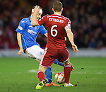 Aberdeen v St Johnstone...01.01.15   SPFL<br /> Steven MacLean is tackled my Mark Reynolds<br /> Picture by Graeme Hart.<br /> Copyright Perthshire Picture Agency<br /> Tel: 01738 623350  Mobile: 07990 594431