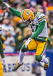 14 December 2014: Green Bay Packers cornerback Sam Shields jumps up prior to facing the Buffalo Bills at Ralph Wilson Stadium in Orchard Park, NY. The Bills defeated the Packers 21-13, snapping the Packers' 5-game winning streak and keeping the Bills' 2014 playoff hopes alive. Mandatory Credit: Ed Wolfstein Photo *** RAW (NEF) Image File Available ***