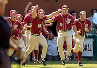 TALLAHASSEE, FL. 6/8/08-The Florida State dug out empties to celebrate after they beat Wichita State 11-4 to advance to the College World Series Sunday during NCAA Super Regional action at Dick Howser Stadium in Tallahassee. FSU has never won the CWS and it has been eight years since their last trip to Omaha. COLIN HACKLEY PHOTO