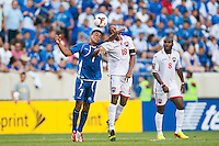 El Salvador midfielder Darwin Ceren (7) goes up for a header with Trinidad and Tobago midfielder Denzil Theobald (18) during a CONCACAF Gold Cup group B match at Red Bull Arena in Harrison, NJ, on July 8, 2013.