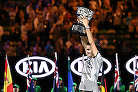 January 29, 2017: Roger Federer of Switzerland raises the trophy after winning the Men's Final against Rafael Nadal of Spain on day 14 of the 2017 Australian Open Grand Slam tennis tournament in Melbourne, Australia. Photo Sydney Low