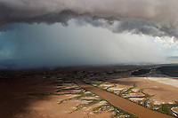 Aerial of tidal mud flats just outside town of Wyndham.  This scene is about one minute away from the landing strip.  We circled in front of this single cell storm as it moved across the landscape.