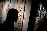 "Visitors walk through a the temporary exhibition hall in the Memorial Hall of the Nanjing Massacre in Nanjing, China, on Thursday, Dec. 13, 2007. After two years of renovations, the Memorial Hall of the Nanjing Massacre reopened to the public on Dec. 13, 2007, the 70th anniversary of the 6-week massacre by Japanese troops that started Dec. 13, 1937 and claimed more than 300,000 lives.  The commemoration comes amid renewed controversy about the accuracy of historical accounts of the massacre.  The massacre is also known as ""The Rape of Nanking."""