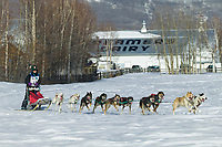 Musher Mari Wood passes Creamers Field on day three of the oldest continuously run sled dog race in the world, the 2003 Open North American Sled dog championships, Fairbanks, Alaska. The annual race consists of three daily races, the combined fastest time wins.