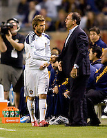LA Galaxy head coach Bruce Arena shakes midfielder David Beckham 's hand before entering the match. The LA Galaxy defeated DC United 2-1at Home Depot Center stadium in Carson, California on Saturday September 18, 2010.