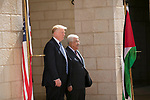 U.S. President Donald Trump and Palestinian President Mahmoud Abbas review the honor guard during a reception ceremony at the presidential headquarters in the West Bank town of Bethlehem, May 23, 2017. APAIMAGES/Fadi Arouri/Pool