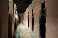 First floor corridor with doors to students' bedrooms in the Bou Inania Madrasa or religious school, founded in 1350 by the Marinid ruler Abu Inan Faris, Meknes, Meknes-Tafilalet, Morocco. Meknes is a fortified Imperial city redeveloped under Sultan Moulay Ismail, 1634-1727, as Morocco's political capital. Picture by Manuel Cohen