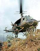 "Duc Pho, Quang Ngai Province, Vietnam - April 24, 1967 -- Operation ""Oregon"", a search and destroy mission conducted by an infantry platoon of Troop B, First Reconnaissance Squadron, 9th Calvary,, First Calvary Division (Airmobile), three kilometers west of Duc Pho, Quang Ngai Province, Vietnam on April 24, 1967.  Members of the reconnaissance platoon are dispatched from an UH-1D helicopter hovering above the ridge line..Credit:  Howard C. Breedlove - U.S. Army via CNP"