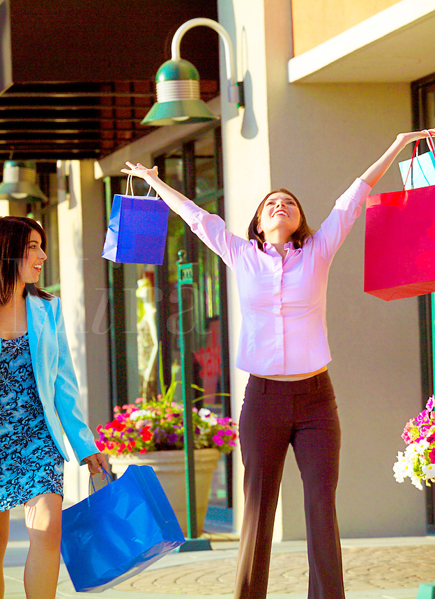 Two women on a shopping spending spree.