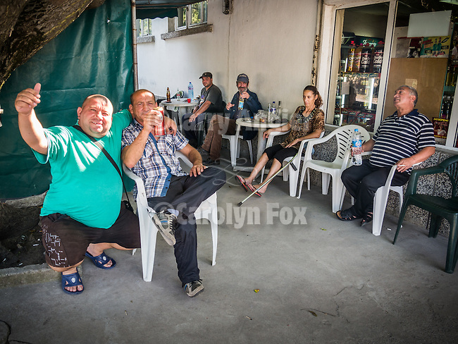 Gathered at the front of a country store to meet the real Bulgarians, Polski Gradec, Bulgaria