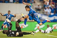 El Salvador forward Rodolfo Zelaya (11) avoids Trinidad and Tobago goalkeeper Jan Michael Williams (21) as he scores during a CONCACAF Gold Cup group B match at Red Bull Arena in Harrison, NJ, on July 8, 2013.