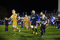Jordan Crane of Bristol Rugby and Guy Mercer of Bath Rugby lead their teams out onto the field. European Rugby Challenge Cup match, between Bath Rugby and Bristol Rugby on October 20, 2016 at the Recreation Ground in Bath, England. Photo by: Patrick Khachfe / Onside Images