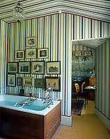 This bathroom and adjacent dressing room have been decorated in an Empire-style tent effect