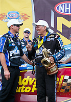 Sep 18, 2016; Concord, NC, USA; NHRA funny car driver John Force (right) celebrates with crew chief Jon Schaffer after winning the Carolina Nationals at zMax Dragway. Mandatory Credit: Mark J. Rebilas-USA TODAY Sports