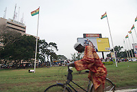 Cycling around Kwame Nkrumah Circle Accra; cell towers and microwave links, MTN network adverts behind.