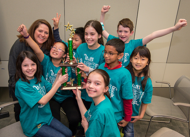 """Students from Roberts Elementary School react after winning the """"Name That Book"""" competition, March 6, 2015."""