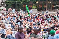 Thousands of people spread their blankets and claim their spots in Bryant Park in New York on Monday, July 11, 2016 for the HBO Bryant Park Summer Film Festival. The park shows films on Monday evenings during the summer attracting a wide range of visitors and up to an estimated 8000 people. (© Richard B. Levine)