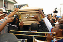 Mourners carry the casket of Hot 8 Brass Band drummer Dinerral Shavers, 25, who died from a gunshot to the back of his head,  2007.