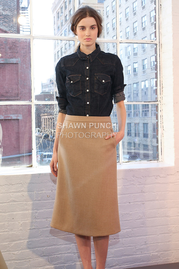 Model poses in an outfit by Marissa Webb, for the J. Crew Womens Fall 2011 Collection presentation.