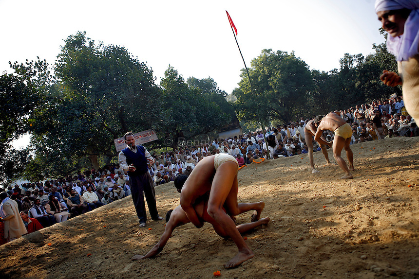 A constant flow of matches overlap, keeping the audience engaged. The ancient tradition of Indian wrestling, known as  kushti, thrives in Varanasi, one of the world's oldest cities. Wrestling gyms, or akhara, scattered around the city are of the few places where Hindu men from different casts are considered equals. Aside from bodybuilding, practiioners emphasize a life of discipline and celibacy. But as modernity sweeps India and Western sports like cricket become more popular, some akhara are being abandoned. While some prominent, government-run gyms switched to mats for Olympic-style wrestling, akhara in villages and towns maintain the old ways.