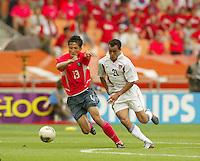 Landon Donovan races for the ball. The USA tied South Korea, 1-1, during the FIFA World Cup 2002 in Daegu, Korea.