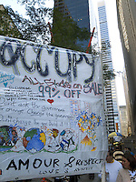 USA. New York City. Occupy Wall Street (OWS) is a people-powered movement that began on September 17, 2011 in Liberty Square in the Wall Street financial district of Manhattan. The protesters have created a small campsite at the Zuccotti Park site. OWS and has spread to over 100 cities in the United States and actions in over 1,500 cities globally. OWS is mainly protesting social and economic inequality, corporate greed, corruption and influence over government&mdash;particularly from the financial services sector&mdash;and lobbyists.  It is fighting back against the corrosive power of major banks and multinational corporations over the democratic process, and the role of Wall Street in creating an economic collapse that has caused the greatest recession in generations. The protesters' slogan, &quot;We are the 99%&quot;, refers to the difference in wealth and income growth in the U.S. between the wealthiest 1% and the rest of the population. OWS aims to expose how the richest 1% of people are writing the rules of an unfair global economy that is foreclosing on our future. OWS has being organized using a non-binding consensus based collective decision making tool known as a &quot;people's assembly&quot;. 22.10.2011 &copy; 2011 Didier Ruef