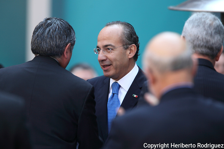 Mexican President Felipe Calderon greets Federal Electoral Institute president  Leonardo Valdes Zurita (L) after giving a speech before bussinesmen and politicians to mark his third year in office during a ceremony in the National Palace in Mexico City, November 29, 2009. Calderon announced he will deliver to Congress a project to reelect deputies and mayors although the Mexican Constitution prohibits it so far. Photo by Heriberto Rodriguez