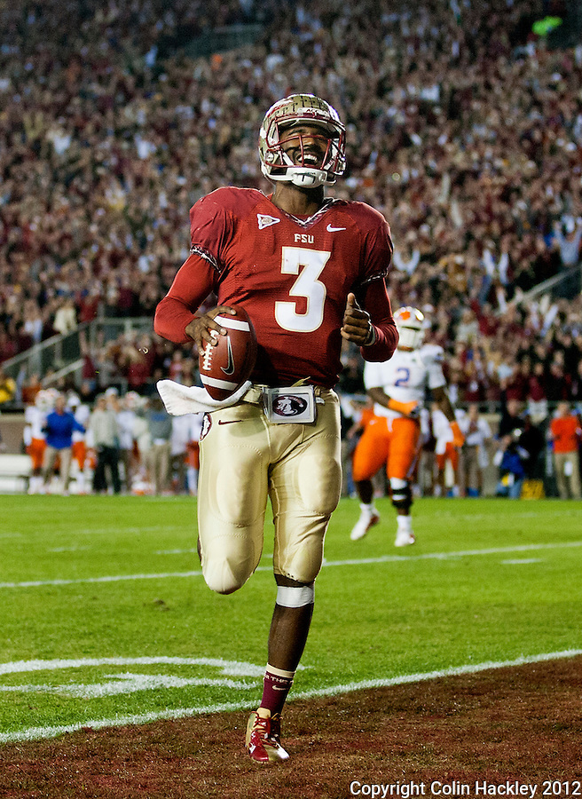 TALLAHASSEE, FL 11/24/12-FSU-UF112412 CH-Florida State's EJ Manuel smiles as he runs alone into the endzone against Florida during second half action Saturday at Doak Campbell Stadium in Tallahassee. The Gators beat the Seminoles 37-26..COLIN HACKLEY PHOTO