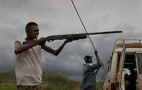 Saltwater Rangers, a program run to try to keep some of the culture that is rapidly disappearing from these areas.  Rain brings life, opens up the habitat and it is the season that some groups of aborigines walk over the landscape spearing, shooting, hooking anything that comes across their path.  They are very effective hunters.<br /> When aborigines were given their rights back to their traditional land, they also made deals for mineral rights, cattle station leases etc... also there are good welfare programs.