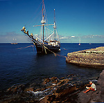 Two masted schooner., moored in Los Cristianos, man in foreground reading a news paper.Tenerife,Canary Islands,Spain