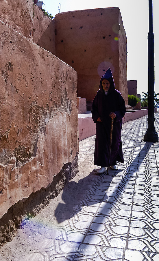 Morocco. Marrakesh medina in the area known as Kasbah. Old man walking the streets.