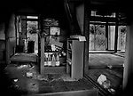 Interior of a building both inside the tsunami zone and the 20km (12.4 miles) nuclear no-entry zone has been partially cleaned up but, due to radiation contamination concerns, this building may not be renovated or reoccupied for many years or even a decade or longer.  Kobama, Fukushima Prefecture, Japan.