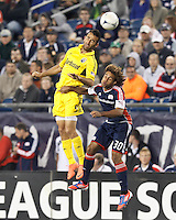 Columbus Crew midfielder Justin Meram (9) and New England Revolution defender Kevin Alston (30) battle for head ball. In a Major League Soccer (MLS) match, the New England Revolution tied the Columbus Crew, 0-0, at Gillette Stadium on June 16, 2012.