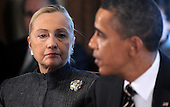 United States Secretary of State Hillary Rodham Clinton listens as U.S. President Barack Obama, right, speaks during a Cabinet Meeting as  in the Cabinet Room, January 31, 2012 at the White House in Washington, DC. .Credit: Olivier Douliery / Pool via CNP