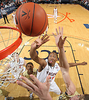 Jan. 22, 2011; Charlottesville, VA, USA; Virginia Cavaliers forward Akil Mitchell (25) shoots between Georgia Tech Yellow Jacket defenders during the game at the John Paul Jones Arena. Virginia won 72-64. Mandatory Credit: Andrew Shurtleff-US PRESSWIRE