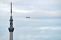 November 13, 2011, Tokyo, Japan - A blimp flies by Tokyo Sky in down town Tokyo on Sunday, November 13, 2011. The 634-meter-high terrestrial digital broadcasting tower will be recognized by Guiness World Records as the worlds tallest senf-standing tower in a ceremony on Thursday. (Photo by Masahiro Tsurugi/AFLO) [2910] -mis-