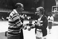 29 December 1986: Lucky Cardinal Classic, Athletic Director Andy Geiger hands all-tournament memento to Kami Anderson.