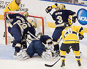 Jesse Todd (Merrimack - 16), Sam Calabrese (Notre Dame - 8), Ben Ryan (Notre Dame - 19), Mike Johnson (Notre Dame - 32), Kyle Bigos (Merrimack - 3), Shayne Taker (Notre Dame - 3), Ryan Flanigan (Merrimack - 20) - The University of Notre Dame Fighting Irish defeated the Merrimack College Warriors 4-3 in overtime in their NCAA Northeast Regional Semi-Final on Saturday, March 26, 2011, at Verizon Wireless Arena in Manchester, New Hampshire.
