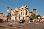 Palazzo Madama and Casaforte degli Acaja on Piazza Castello in Turin, Italy with the Royal Palace in the background and a tram line in the foreground