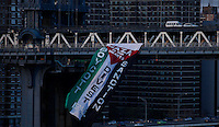 New York City, NY. 20 August 2014. A Pro-palestine Flag hangs from the Manhattan Bridge while a group of people holds a Rally across the Brooklyn Bridge in Manhattan. Photo by Kena Betancur/VIEWpress