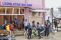Philippines. Province Eastern Samar. Hernani. Town hall. 95 % of the town was destroyed by typhoon Haiyan's winds and storm surge. A group of policemen armed with M-16 machine guns. M-16 is a rifle adapted for semi-automatic and full-automatic fire. Typhoon Haiyan, known as Typhoon Yolanda in the Philippines, was an exceptionally powerful tropical cyclone that devastated the Philippines. Haiyan is also the strongest storm recorded at landfall in terms of wind speed. Typhoon Haiyan's casualties and destructions occured during a powerful storm surge, an offshore rise of water associated with a low pressure weather system. Storm surges are caused primarily by high winds pushing on the ocean's surface. The wind causes the water to pile up higher than the ordinary sea level. 26.11.13 © 2013 Didier Ruef