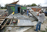After Hurricane Gustav destroyed it, Frog Carlos, wondered where to start cleaning up what used to be his bar in Houma, Louisiana September 2, 2008    (Mark Wallheiser/TallahasseeStock.com)