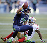 Seattle Seahawks wide receiver Jermaine Kearse (15) comes up with  a 47-yard pass against  San Francisco 49ers  cornerback Perrish Cox (20) during the first quarter  at CenturyLink Field in Seattle, Washington on December 14, 2014.  The Seahawks beat the 49ers 17-7.   © 2014. Jim Bryant Photo. All Rights Reserved.