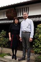"""Tokubee Masuda, CEO of the Tsukinokatsura sake brewery with his wife Kahoru, Fushimi, Kyoto, Japan, October 10, 2015. Tsukinokatsura Sake Brewery was founded in 1675 and has been run by 14 generations of the Masuda family. Based in the famous sake brewing region of Fushimi, Kyoto, it has a claim to be the first sake brewery ever to produce """"nigori"""" cloudy sake. It also brews and sells the oldest """"koshu"""" matured sake in Japan."""