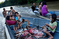 The Baihua and Tega familes, from the Waorani (Huaroni) community of Bameno, travel home together by boat on the Canonoco River after a successful hunt for monkey, pecary and deer in the surrounding rainforest.