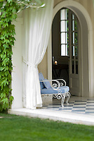 French windows open into the house from the tiled loggia