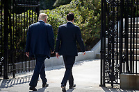 US President Donald J. Trump (L) and Secretary of Treasury Steven Mnuchin (R) walk to the White House after a financial services Executive Order signing ceremony at the Treasury Department in Washington, DC, USA, 21 April 2017. President Trump is making his first visit to the Treasury Department for a memorandum signing ceremony with Secretary Mnuchin.<br /> Credit: Shawn Thew / Pool via CNP /MediaPunch